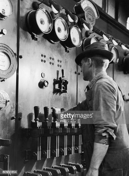 A worker operating industrial electrical equipment USA circa 1940