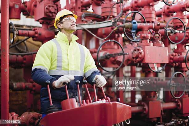 Worker operating machinery on oil rig