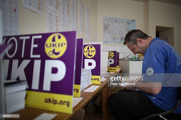 A worker organises leaflets in the campaign office of UK Independence Party candidate Douglas Carswell on April 8 2015 in ClactononSea England Mr...
