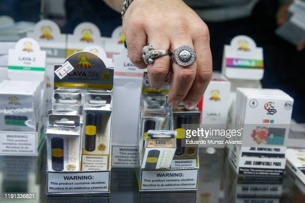 Worker organizes E-cigarette disposable units in a local store on January 2, 2020 in Jersey City, New Jersey. The Trump administration will announce...