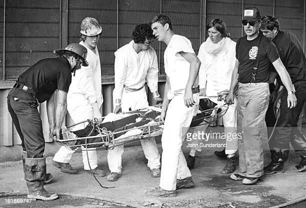 AUG 4 1981 AUG 5 1981 Worker overcome by fumes rescued by firemen and paramedics A fireman and paramedics rescued Willie Owens 2234 Clarkson St from...