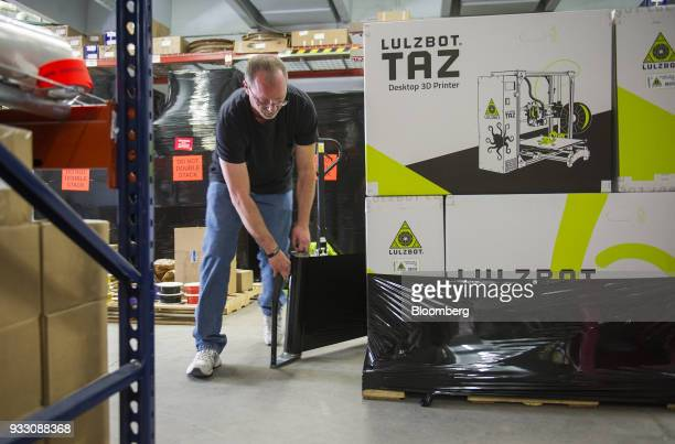 A worker packages a LulzBot TAZ 3D printer at the Aleph Objects Inc production facility in Loveland Colorado US on Wednesday March 14 2018 Aleph...