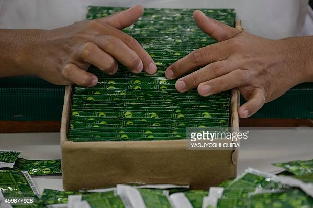 A worker packages condoms made with native latex at the Natex factory that produces around 100 million condoms per year for the Brazilian Health...