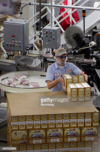 A worker packages gluten free products at the Bob's Red Mill and Natural Foods facility in Milwaukie Oregon US on Tuesday April 8 2014 Bob's Red Mill...