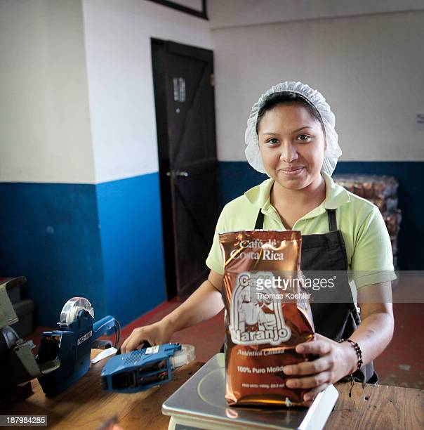 Worker packaging coffee of the coffee plantation Espiritu Santo the plantation is member of the coffee cooperative Coopronaranjo RL which is...