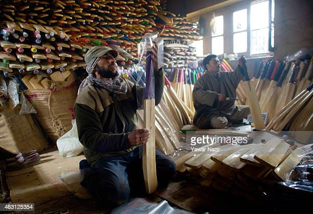 A worker packs cricket bats in a factory on February 10 2015 in Halmullah 50 km south of Srinagar the summer capital of Indian administered Kashmir...