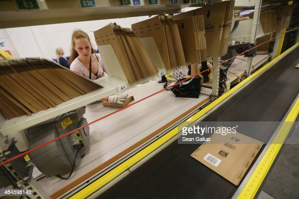 A worker packs orders at an Amazon warehouse on September 4 2014 in Brieselang Germany Germany is online retailer Amazon's second largest market...