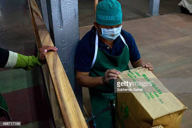 A worker packs tea at Makaibari tea factory Set up in 1859 off Kurseong in the Darjeeling hills the Makaibari estate is the worlds first tea factory...