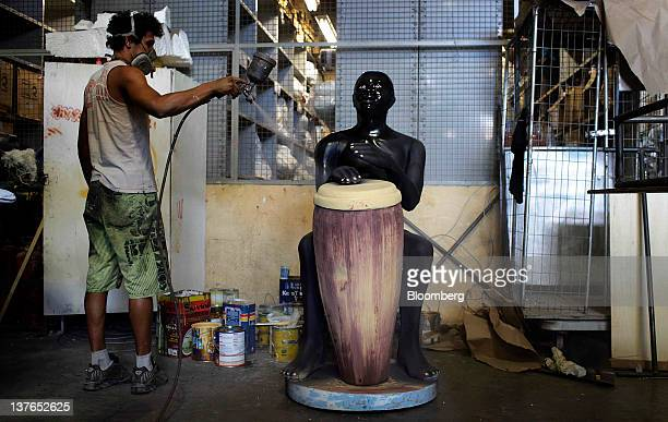 A worker paints a float at the BeijaFlor samba school factory shed in Rio de Janeiro Brazil on Thursday Jan 19 2012 Rio Carnival is a 4 day...