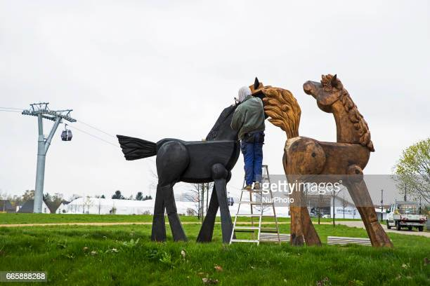 A worker paints a horse figure in the water play area during a press preview of the IGA 2017 in Berlin Germany on April 7 2017 Last arrangements are...