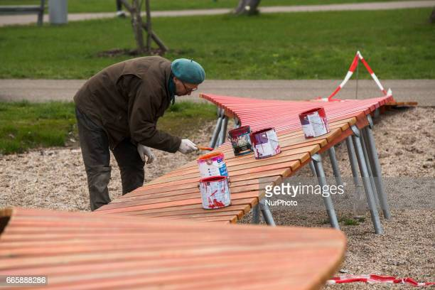 A worker paints a path in the water play area during a press preview of the IGA 2017 in Berlin Germany on April 7 2017 Last arrangements are being...