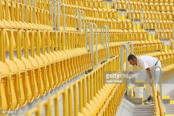 Worker paints a stairway at the new Rudolf-Harbig soccer stadium under construction on August 6, 2008 in Dresden, Germany. Officials from DFB and...