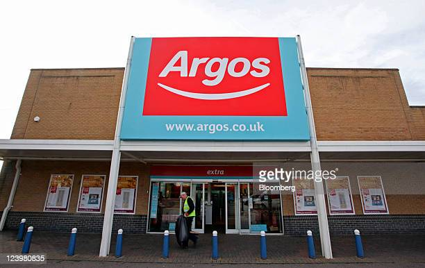 A worker passes an Argos store operated by Home Retail Group Plc in Enfield UK on Wednesday Sept 7 2011 Home Retail Group Plc owner of the UK catalog...