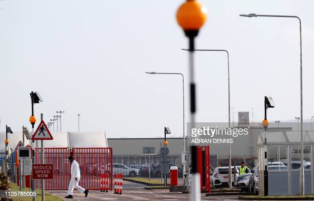 A worker passes an entrance gate at the Honda manufacturing plant in Swindon southwest England on February 19 2019 Honda announced Tuesday it would...