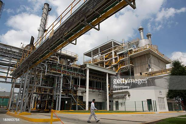 A worker passes by a boiler at the Nestle SA chocolate production plant plant in Toluca Mexico on Wednesday Oct 2013 Nestle SA the worlds biggest...