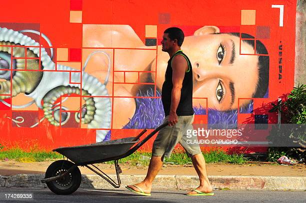 Worker passes in front of a grafitti painted in a public wall at a poor neighborhood. Again, no preparation, only waited to something happen in front...