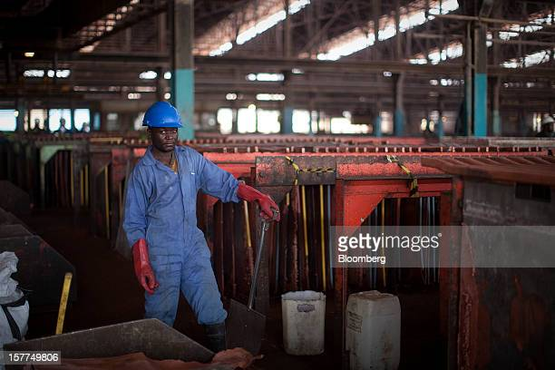 A worker pauses as he works in the metallurgical plant at Katanga Mining Ltd's copper and cobalt mine in Kolwezi Katanga province Democratic Republic...