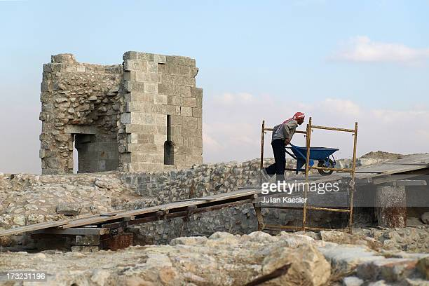 CONTENT] A worker performing ongoing restoration at the Aleppo Citadel Whilst there is evidence of defenses on the site dating back some 3000 years...