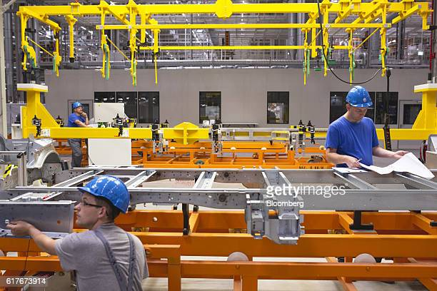 A worker performs a quality control test on a part of a Volkswagen AG Crafter van on the production line inside the newly opened Volkswagen AG...