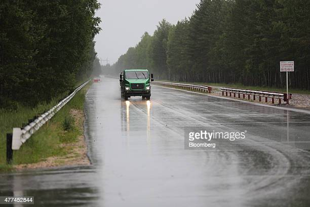 A worker performs a road test with a GAZon Next truck on the test track at the Gaz automobile plant operated by Gaz Group in Nizhny Novgorod Russia...