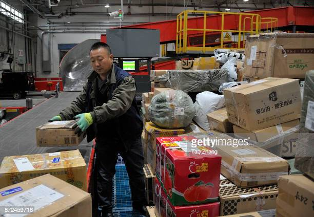 A worker pick up parcels on November 10 2017 in Harbin China November 11 is known in China as Singles Day because the date 1111 resembles four 'bare...