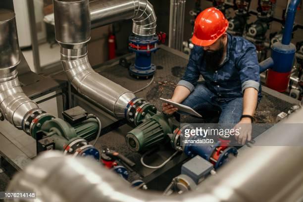 werknemer - industriële apparatuur stockfoto's en -beelden
