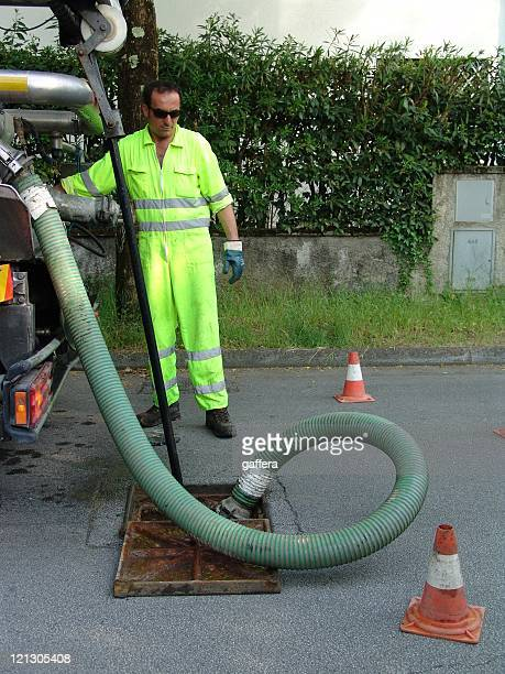 worker - drain cleaner stock photos and pictures