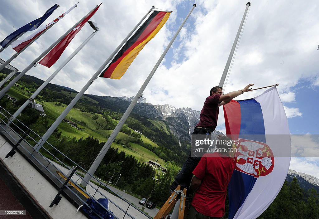 Worker place the Serbian flag outside the Hotel Krallerhof in Leogang, Austria, where the Serbian national football team is staying while holding a training camp to prepare for the 2010 World Cup in South Africa.