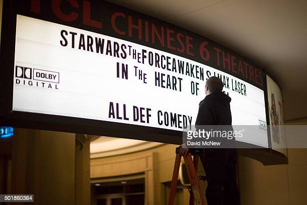 A worker places letters on the marquee on opening night of Walt Disney Pictures And Lucasfilm's Star Wars The Force Awakens at the TCL Chinese...
