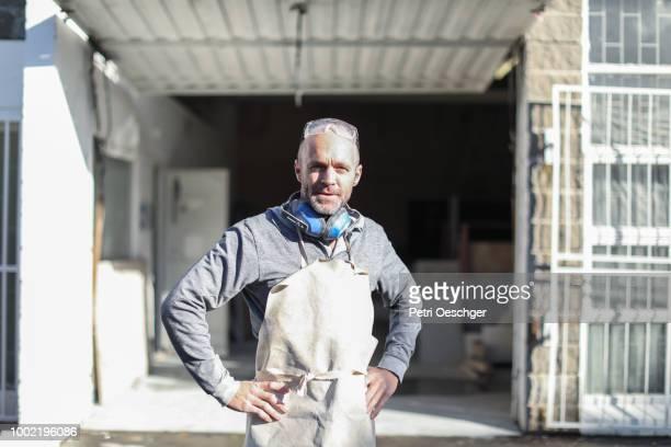 worker planning in his workshop. - handwerker stock-fotos und bilder