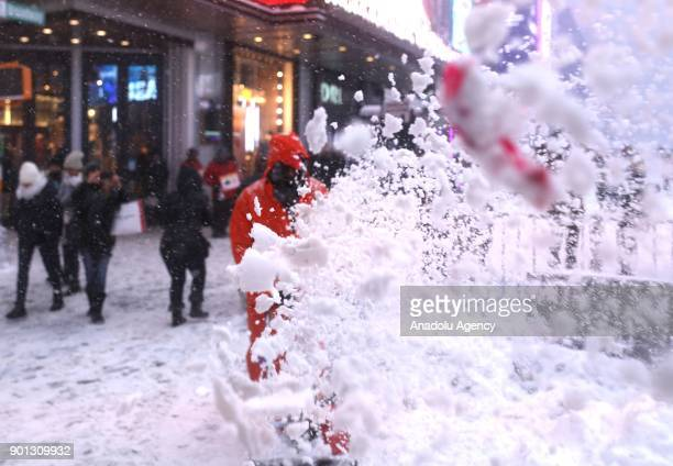 A worker plows through the street during a snowstorm near Times Square in New York United States on January 04 2018