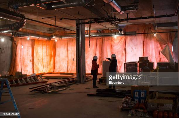 A worker points to a section of the Josie Hotel under construction at the Red Mountain ski resort in Rossland British Columbia Canada on Wednesday...