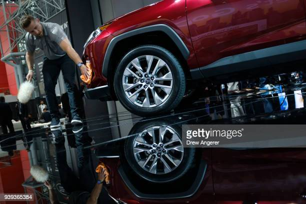 A worker polishes a 2019 Subaru Forester at the New York International Auto Show March 28 2018 at the Jacob K Javits Convention Center in New York...