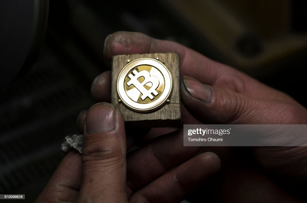 A worker polishes a brass Bitcoin medal produced by Sakamoto Metal at a workshop on January 25, 2018 in Tokyo, Japan. Sakamoto Metal, a custom medal, coin and pin badge maker in Tokyo, produces 24K gold and brass bitcoin medals that went on sale in January as investments in cryptocurrencies become popular in the country after Japan's government passed a law recognising bitcoin and other alternative coins as legal tender in 2017.