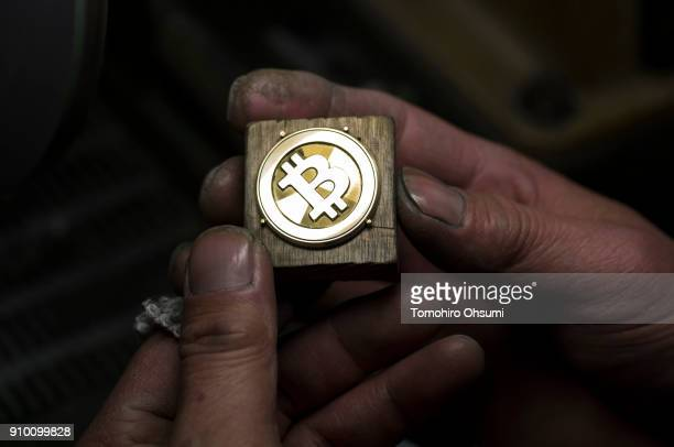 A worker polishes a brass Bitcoin medal produced by Sakamoto Metal at a workshop on January 25 2018 in Tokyo Japan Sakamoto Metal a custom medal coin...