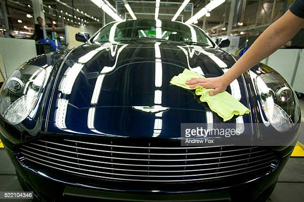 Worker Polishes Aston Martin DB9