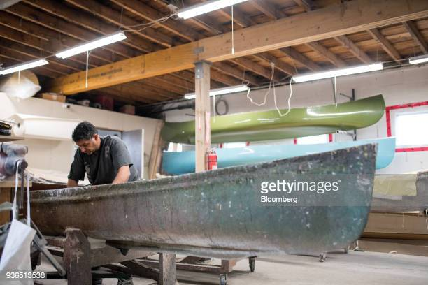 A worker polishes the interior of a canoe mold at the Holy Cow Canoe Co production facility in Guelph Ontario Canada on Thursday March 1 2018...