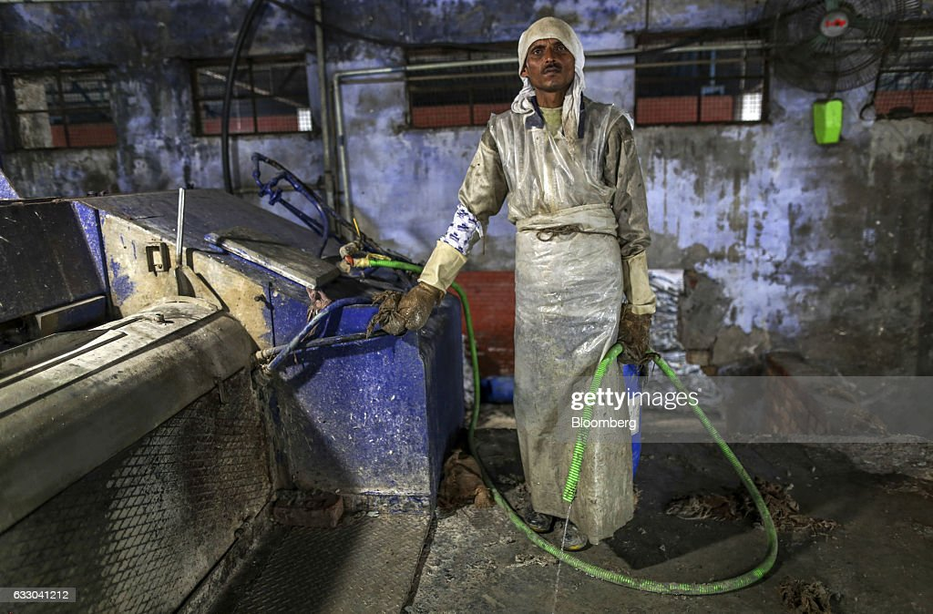 A worker poses for a photograph at the Jalandhar Leather Pvt tannery in Jalandhar Punjab India on Friday Jan 20 2017 India`s 51 million micro small...