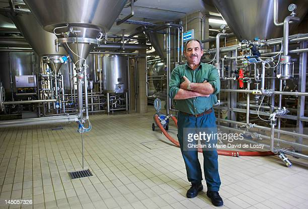 worker posing in trappist brewery - belgium stock pictures, royalty-free photos & images