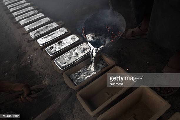 A worker pours liquid aluminium into casts in Dhaka Bangladesh on 22 August 2016 People from the southern part of Bangladesh are the victims of...