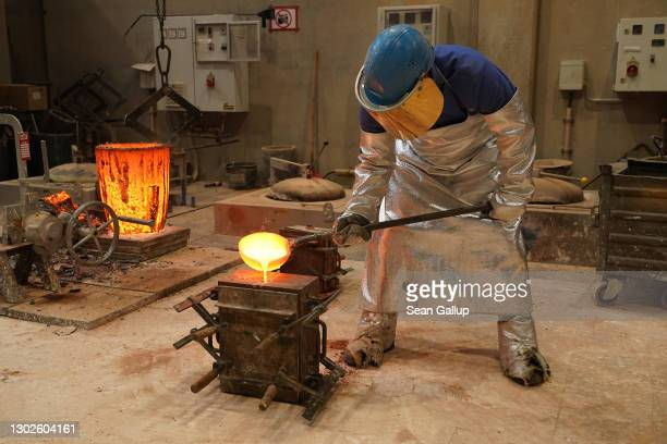 Worker pours molten bronze into a mould to cast a Berlinale bear trophy at the Hermann Noack Bildgiesserei foundry for the 71st Berlin International...