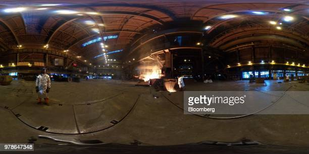 A worker pours molten cast iron collected from a blast furnace in the converter shop at the Novolipetsk Steel PJSC plant operated by NLMK Group in...