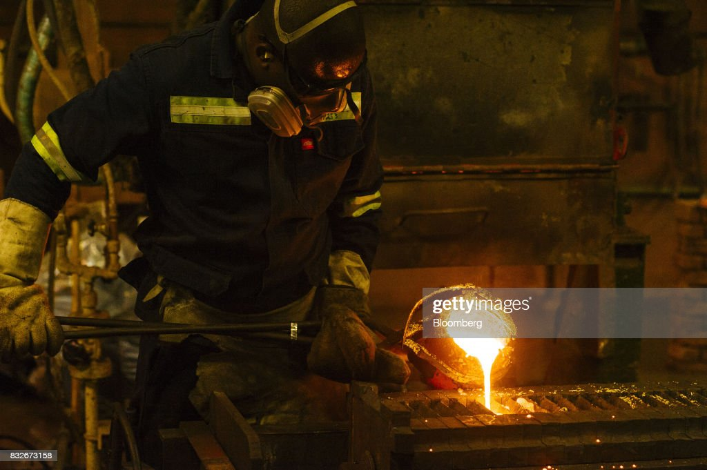A worker pours molten gold into a mould during the refining of bullion at the Rand Refinery Ltd. plant in Germiston, South Africa, on Wednesday, Aug. 16. 2017. Established by the Chamber of Mines of South Africa in 1920, Rand Refinery is the largest integrated single-site precious metals refining and smelting complex in the world, according to their website. Photographer: Waldo Swiegers/Bloomberg via Getty Images