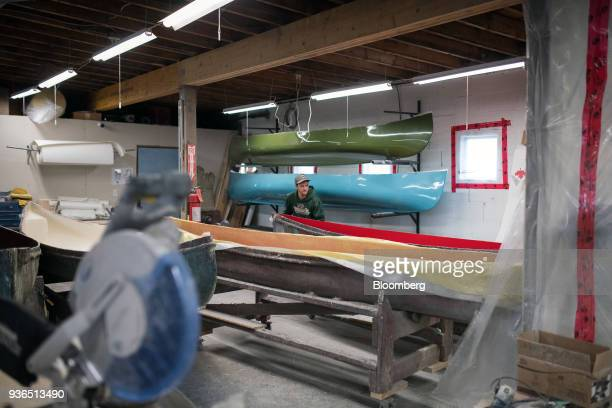 A worker prepares a canoe for fiberglass shell at the Holy Cow Canoe Co production facility in Guelph Ontario Canada on Thursday March 1 2018...