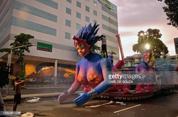 TOPSHOT A worker prepares a carnival float outside the Sambadrome in Rio de Janeiro on February 21 2020 Rio's world famous annual carnival has begun...