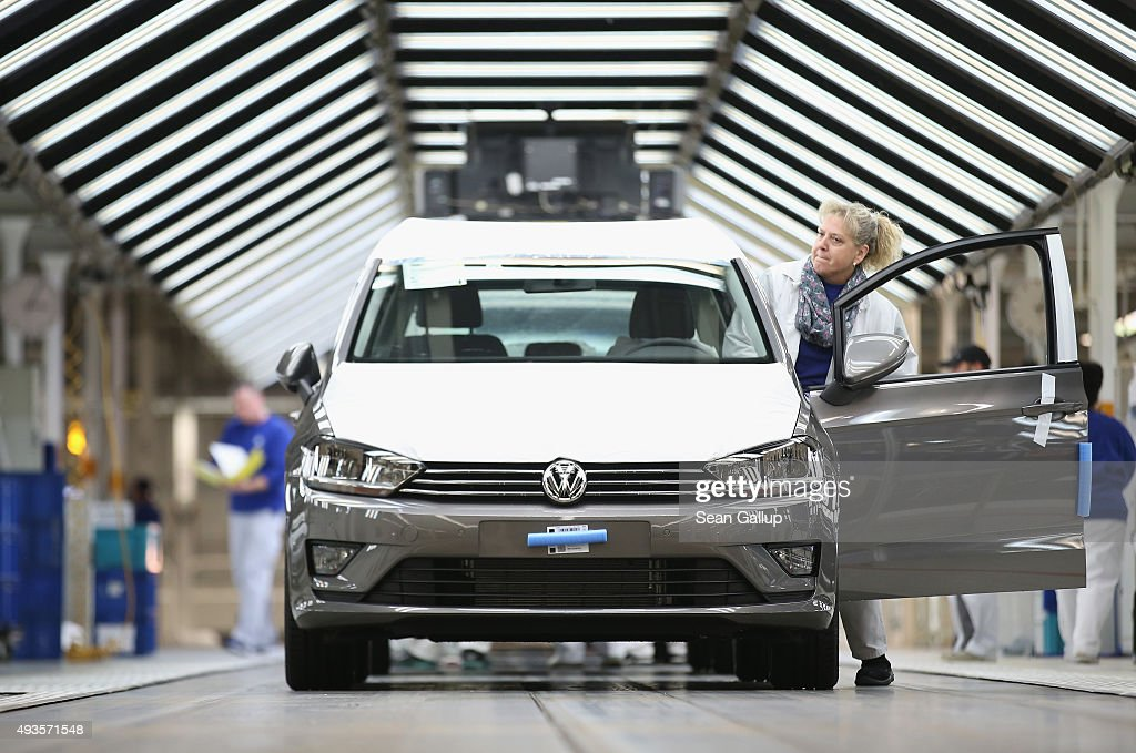A worker prepares a finished Volkswagen car for transport at the end of the assembly line prior to a visit by Volkswagen Group Chairman Matthias Mueller and Lower Saxony Governor Stephan Weil at the Volkswagen factory on October 21, 2015 in Wolfsburg, Germany. The two toured the plant and met with workers as Volkswagen continues to struggle through the wake of the Volkswagen diesel emissions scandal. The company installed software that cheats during emissions test into 11 million of its diesel cars sold worldwide.
