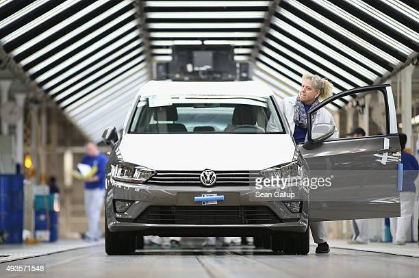 A worker prepares a finished Volkswagen car for transport at the end of the assembly line prior to a visit by Volkswagen Group Chairman Matthias...