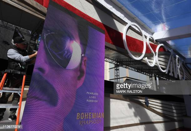 A worker prepares a monitor showing the Bohemiam Rhapsody movie poster on the red carpet area as preparations for this years Oscars take place in...