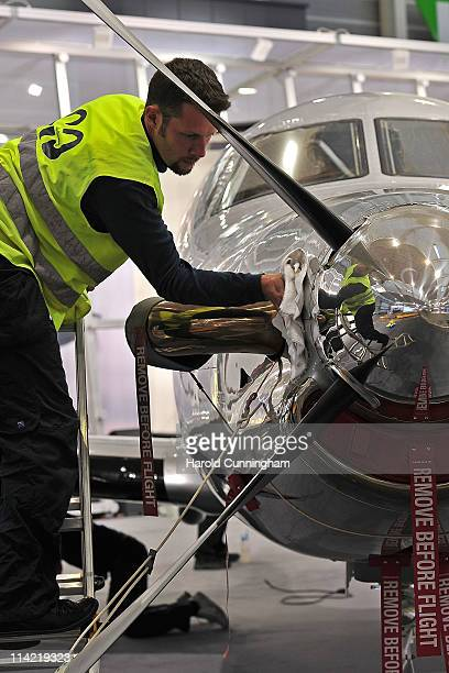 Worker prepares a Pilatus aircraft for the 11th annual European Business Aviation Convention and Exhibition held at Geneva International Airport and...