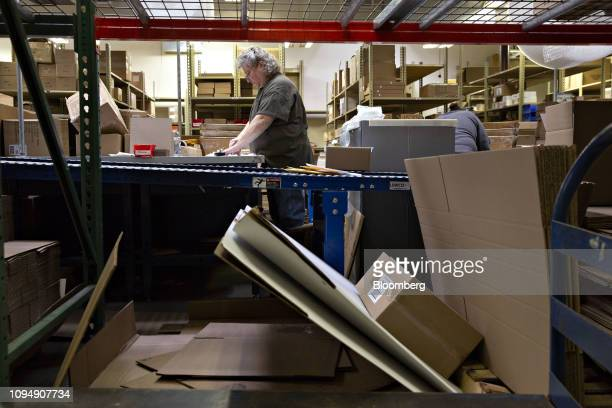 A worker prepares a shipment in the directtoconsumer packaging area at the Primex Family of Cos facility in Lake Geneva Wisconsin US on Tuesday Jan...